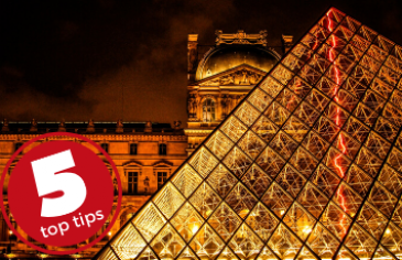 5 top tips for embracing culture. The Louvre museum and glass pyramid illuminated at night