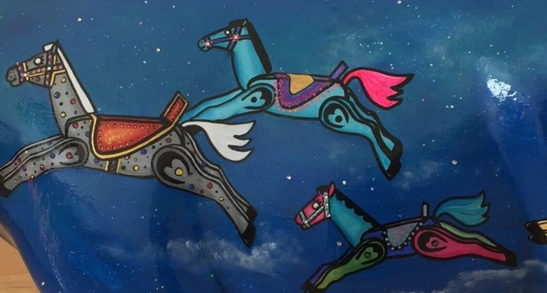 Museum of Cambridge mini-moo, rocking horses on a night sky by artist Marlis Horgan