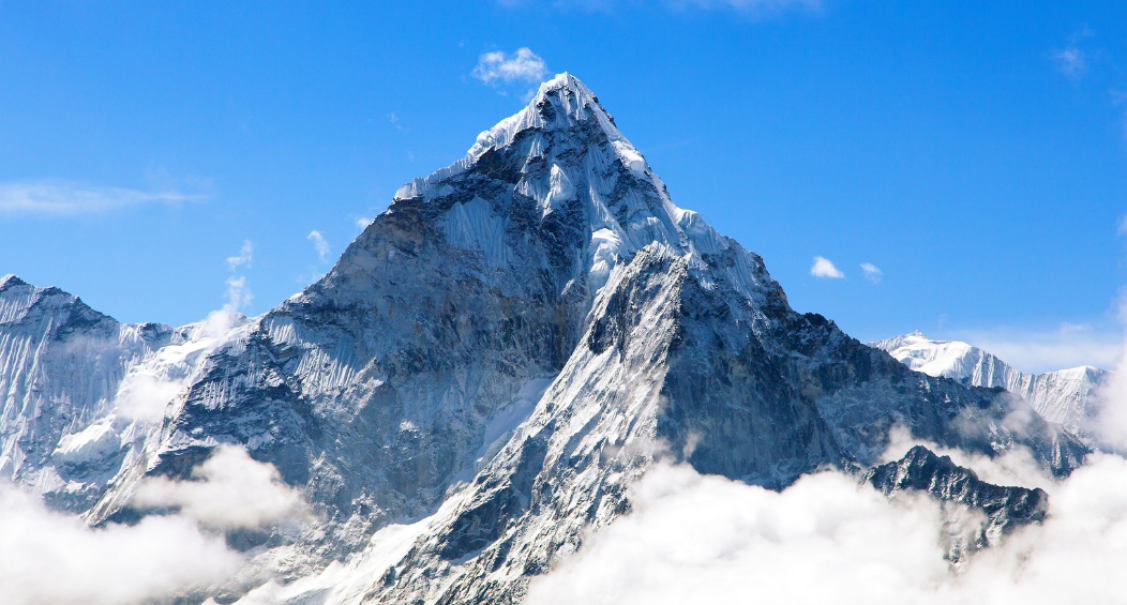 The peak of mount Everest on a sunny day